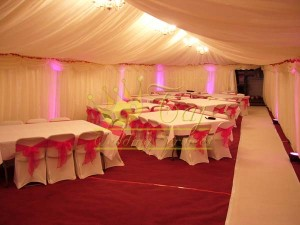 fully-lined-marquee-in-harrow-with-wedding-uplights-and-stage-decor1
