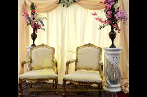 12. Gold arm chairs